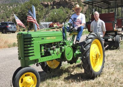 Kenny Owens volunteered his antique John Deere tractor to pull the trolley car.  Also pictured, Craig Leitner.