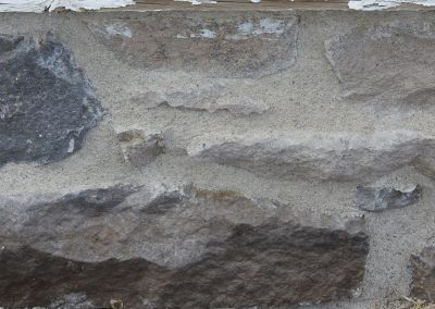 Section of foundation that has new mortar.