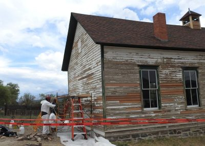 Jon Sargent and team scraped the old paint from the west side of the building and started on the north side.