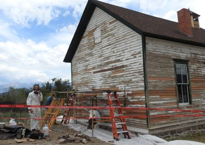 Progress is being made by Jon's team on replacing the siding and scraping off the old paint.