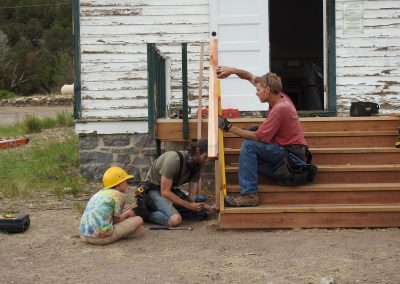 Gunnar Kintgen, a Howard resident, intently listens while Jon Sargent and his helper work on the stairs.